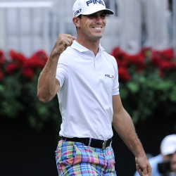 Billy Horschel reacts after sinking a short putt on the 18th green to win the Tour Championship golf tournament and the Fed X Cup Sun