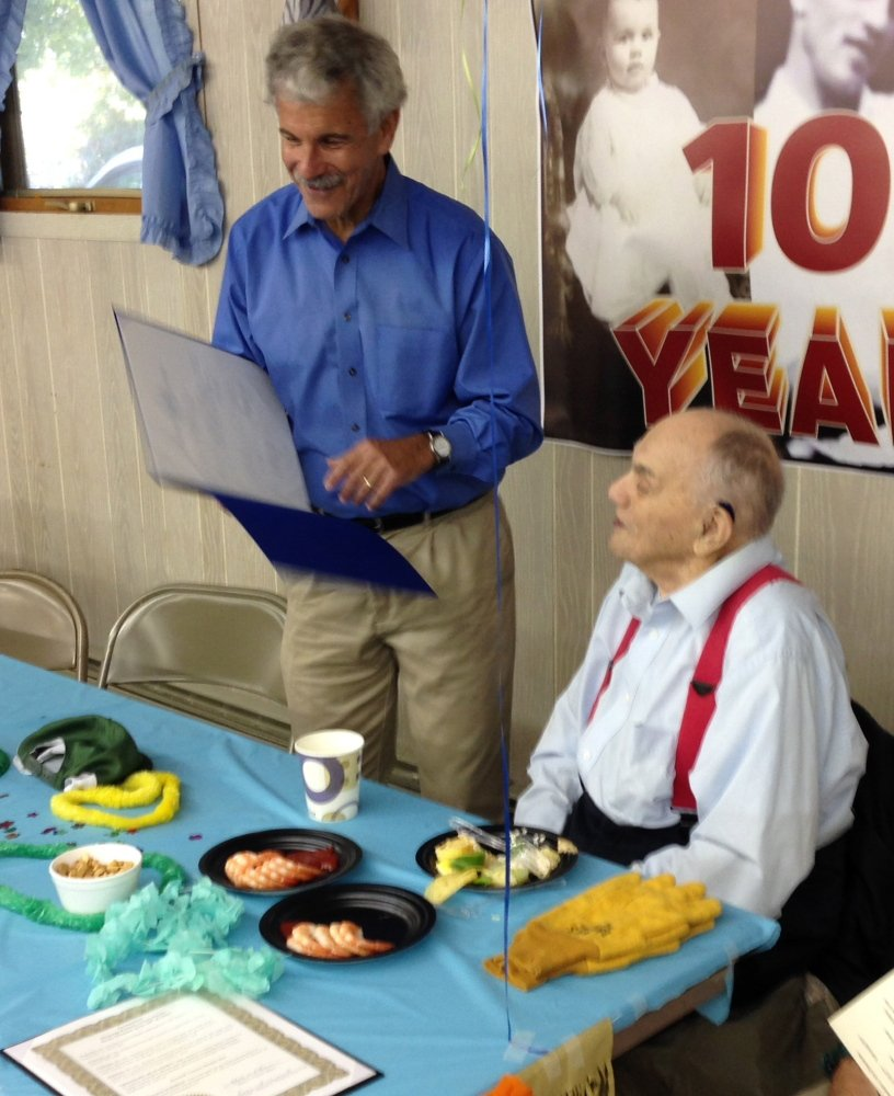 Sen. Roger Katz, R-Kennebec, left, recently presented a legislative sentiment to Kenneth Barden, right, at a party honoring him on his 100th birthday. More than 100 friends and relatives came to the Fox Glen Snowmobile Club to celebrate his life. Barton was the proprietor of Barden's Shop-Rite in Augusta, which was a local institution. He also had a location in Winthrop.
