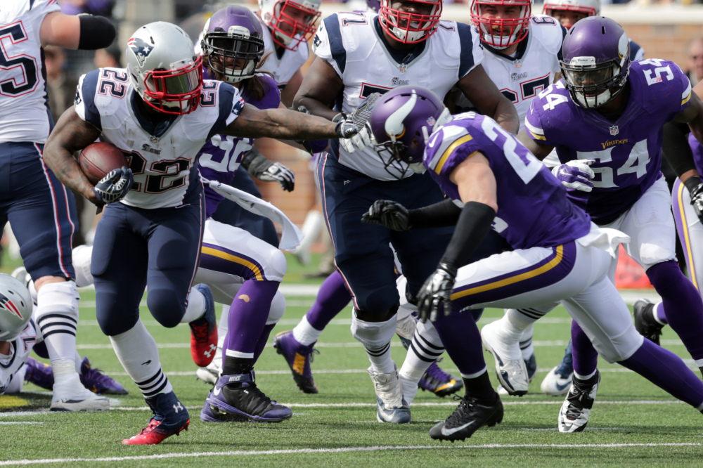New England Patriots running back Stevan Ridley (22) carries the ball for a 16-yard gain as Minnesota Vikings free safety Harrison Smith defends during the fourth quarter Sunday in Minneapolis. The Patriots won 30-7.