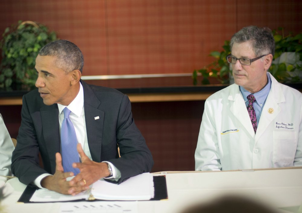 President Barack Obama talks during a meeting with Emory University doctors and healthcare professionals at the Centers for Disease Control and Prevention in Atlanta on Tuesday. Sitting with Obama is Dr. Bruce S. Ribner, professor of medicine in the School of Medicine and Department of Medicine, Division of Infectious Diseases.