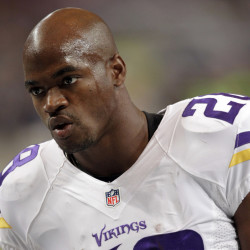 In this file photo, Minnesota Vikings running back Adrian Peterson warms up for an NFL football game against the St. Louis Rams in St. Louis. The Vikings benched Peterson for Sunday's game after his attorney said he had been indicted by a Texas grand jury on a charge of ch