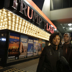 Ruth Hardrick, a dealer who worked at Trump Plaza Hotel & Casino for 26 years, stands with friend, Anthony Powell, on The Boardwalk, as she answers a question after the casino closed early Tuesday in Atlantic City, N.J.