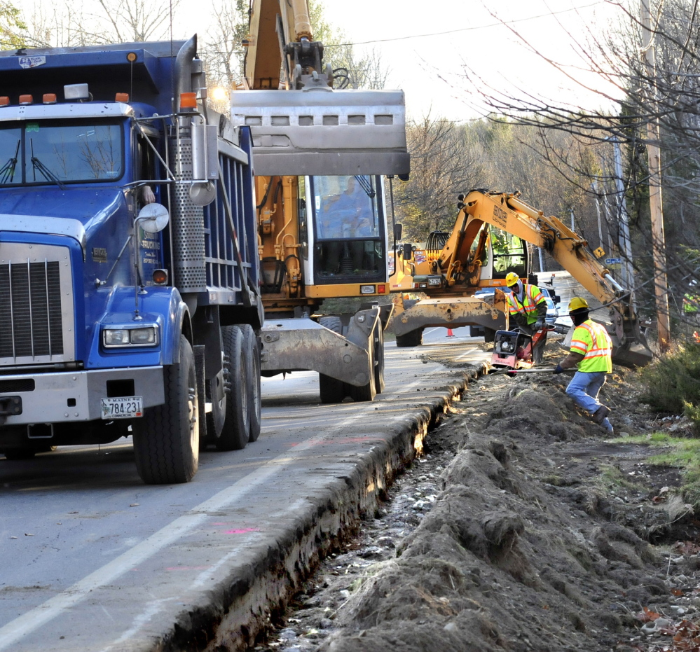 Workers bury installed natural gas pipeline in Fairfield in 2013. Two companies announced plans Tuesday to expand natural gas access in New England.