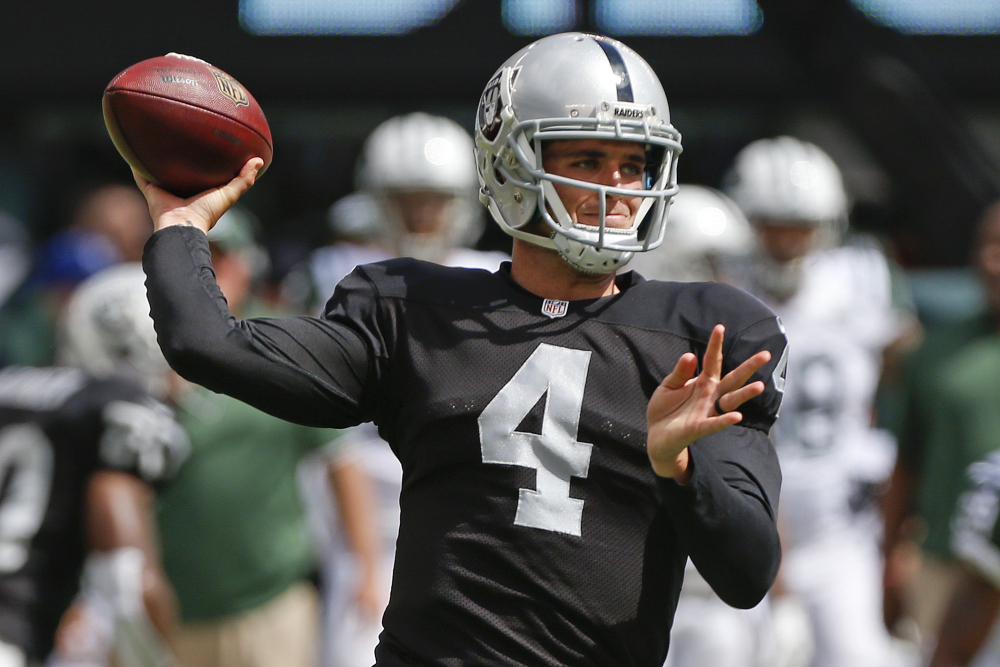 Quarterback Derek Carr (4) and the Oakland Raiders travel to Foxborough, Mass. on Sunday to play against the New England Patriots. Carr, a rookie, has two games of NFL experience.