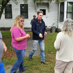 """Mike Wolfe, center, a co-host for the reality TV program """"American Pickers,"""" signs autographs and poses for pictures with fans outside 11 Pleasant St. in Skowhegan, where the show went to buy antiques."""
