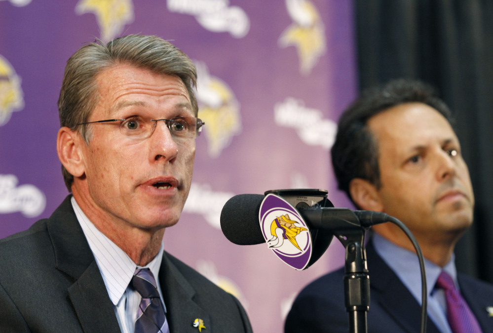 """Rick Spielman, the Minnesota Vikings' executive vice president and general manager, speaks Wednesday as owner-chairman Mark Wilf listens during a news conference in Eden Prairie, Minn. Hours after reversing course and benching Adrian Peterson indefinitely, team owner Zygi Wilf said the team """"made a mistake"""" in bringing back its star running back after his indictment on a child-abuse charge in Texas."""