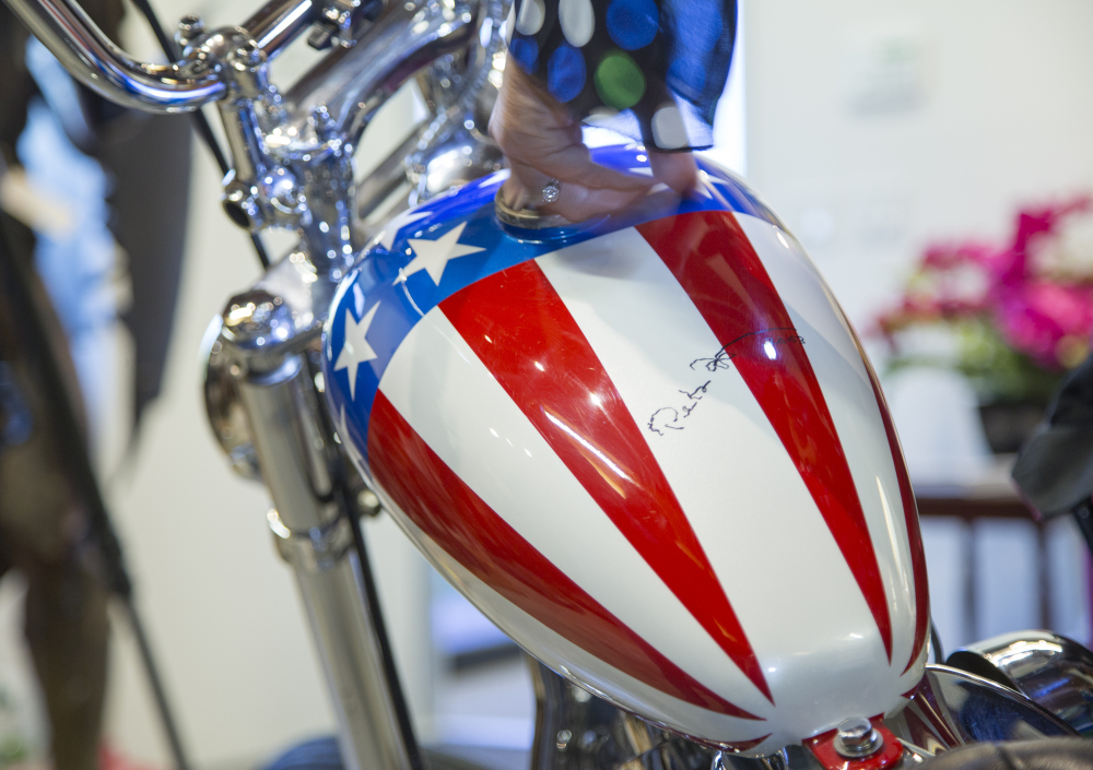 "This photo shows the autographed gas tank of the Captain America chopper Peter Fonda rode in ""Easy Rider"" at the Profiles in History auction house in Calabasas, Calif."