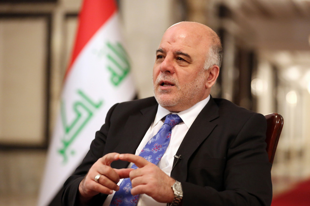 Iraq's Prime Minister Haider al-Abadi speaks during an interview with The Associated Press in Baghdad, Iraq, Wednesday.