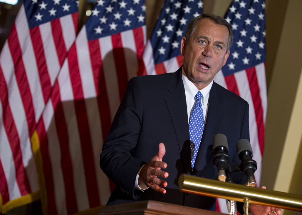 House Speaker John Boehner of Ohio gestures while speaking outside his office on Capitol Hill in Washington in this 2013 photo.