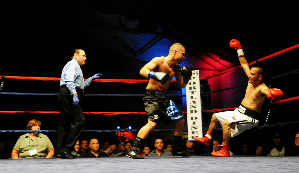Light welterweight Brandon Berry knocks down Moises Rivera in the second round at the Portland Expo on June 14. Berry scored a technical knockout in the second round to improve his pro record to 6-0.