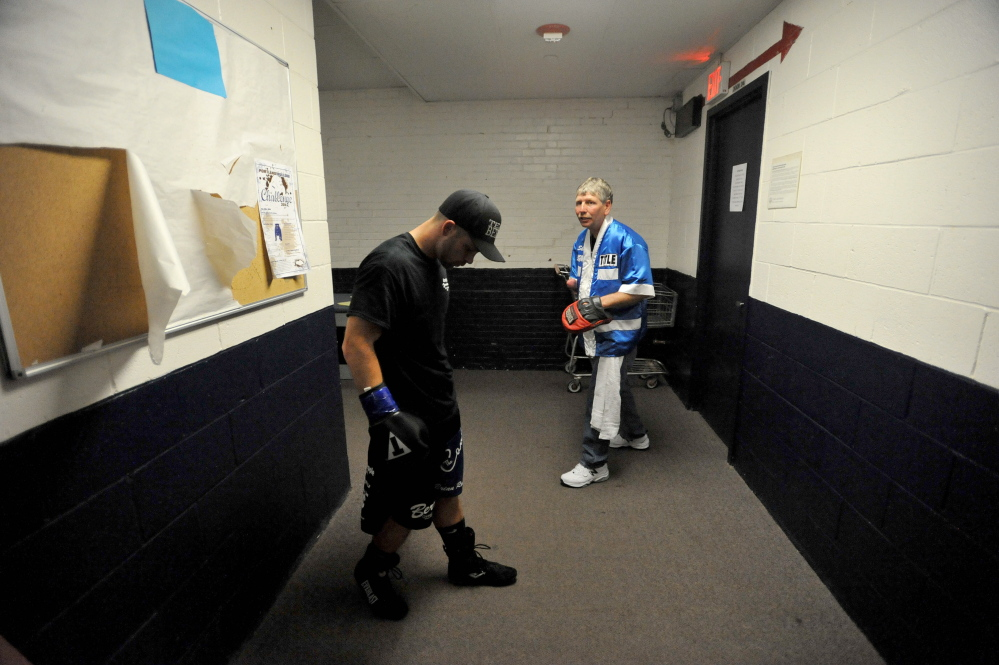 Light welterweight Brandon Berry warms up with his trainer Skeet Wyman for his sixth professional fight at the Portland Expo on June 14. Berry scored a technical knockout of opponent Moises Rivera in the second round to improve his pro record to 6-0.