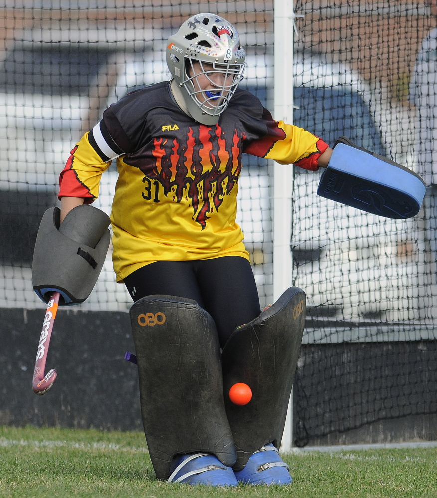 Hall-Dale High School goalie Molly French turns aside a shot during a Mountain Valley Conference game Monday against Winthrop.