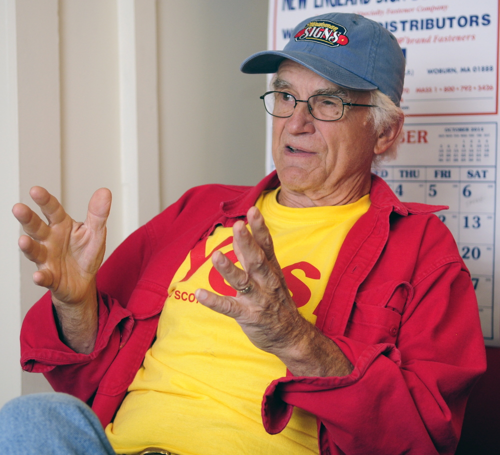 Bill McKeen talks about the Scottish independence vote during an interview on Tuesday at his business, Minuteman Signs in Augusta.