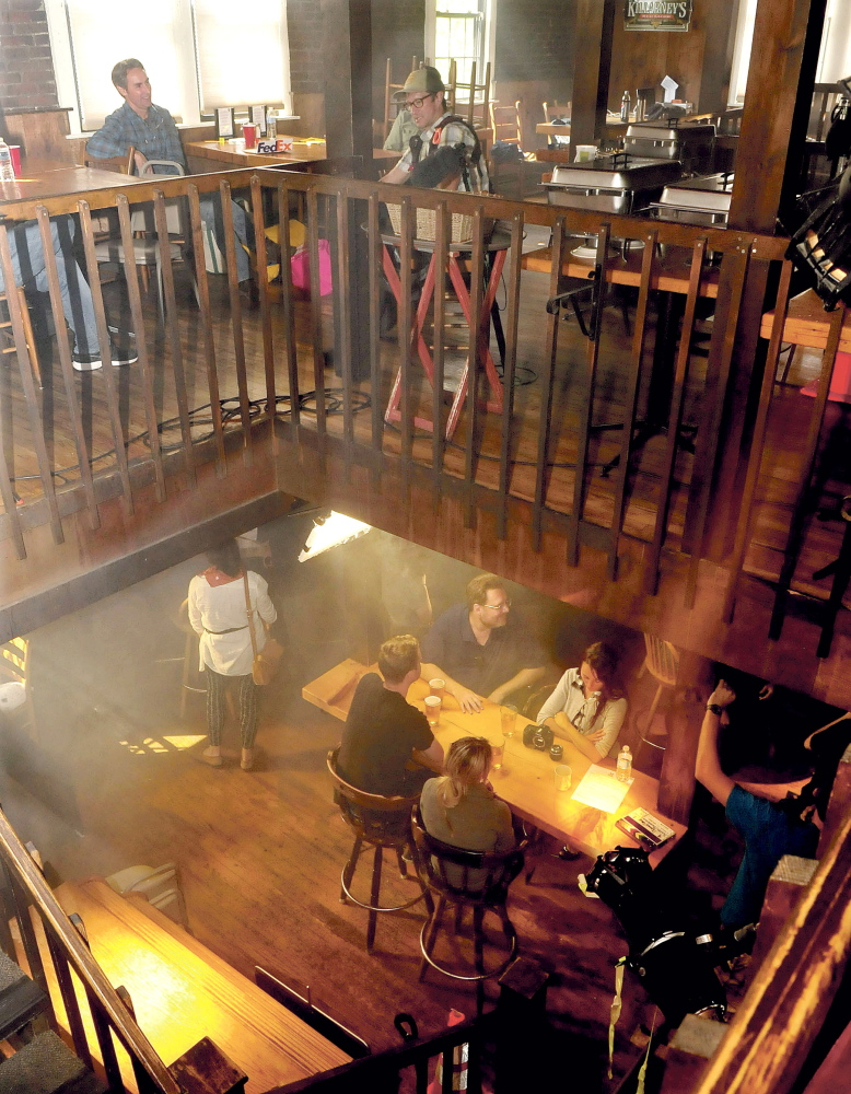 """American Pickers"" star Mike Wolfe, top left, extras and production staff fill two floors of the Old Mill Pub in Skowhegan before filming promotional commercials for ""American Pickers"" and ""Down East Dickering."""