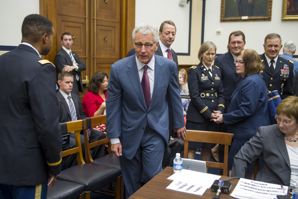 Secretary of Defense Chuck Hagel walks to the witness table to testify before the House Armed Services Committee on Capitol Hill in Washington on Thursday. Hagel reiterated that if the Islamic State militants are left unchecked, they will threaten the United States and its allies.