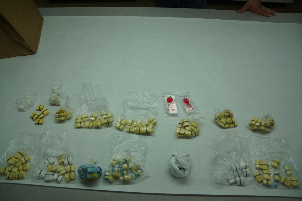 Augusta police display illegal drugs they say were seized in a raid Wednesday at a River Street residence.