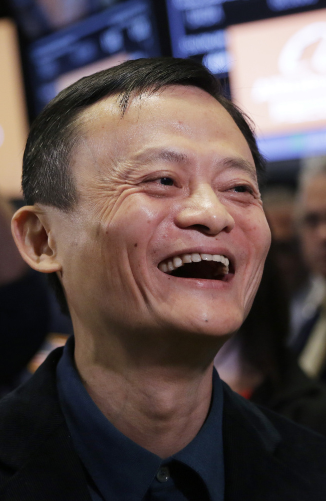 "Jack Ma, founder of Alibaba, beams on the floor of the New York Stock Exchange on Friday. ""We want to be bigger than Wal-Mart,"" he said."
