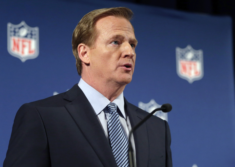 NFL Commissioner Roger Goodell, seen speaking at a news conference Friday in New York, says the NFL wants to adopt new personal conduct policies by the Super Bowl. The league has faced increasing criticism that it has not acted quickly or emphatically enough in response to domestic abuse cases.