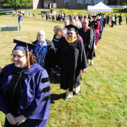 Rising Scholars and faculty members process toward their seats during the convocation on Friday at the University of Maine at Augusta.