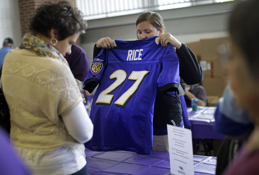 A worker folds up a former Baltimore Ravens running back Ray Rice jersey that a fan traded in on Friday at M&T Bank Stadium in Baltimore. The Ravens offered fans a chance to exchange their Rice jerseys for those of another player after he was cut by the team and suspended indefinitely by the NFL for domestic violence.