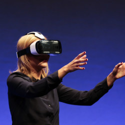 British television presenter Rachel Riley shows a virtual-reality headset called Gear VR during an unpacked event of Samsung ahead of the consumer electronic fair IFA in Berlin. Oculus, the virtual reality company acquired by Facebook earlier this year for $2 billion, is holding its first-ever developers conference and discussed the much-anticipated release of its VR headset for consumers.
