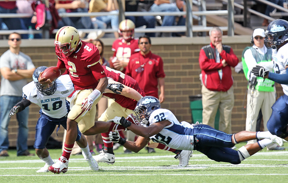 Boston College quarterback Tyler Murphy breaks away from Maine's Randy Samuels to start a touchdown run in the first quarter Saturday in Boston.