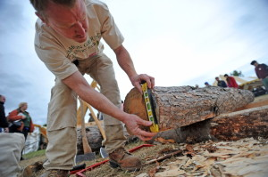 Ryan Brubaker squares a log to hand mill during a demonstration Saturday at the Common Ground Fair in Unity.