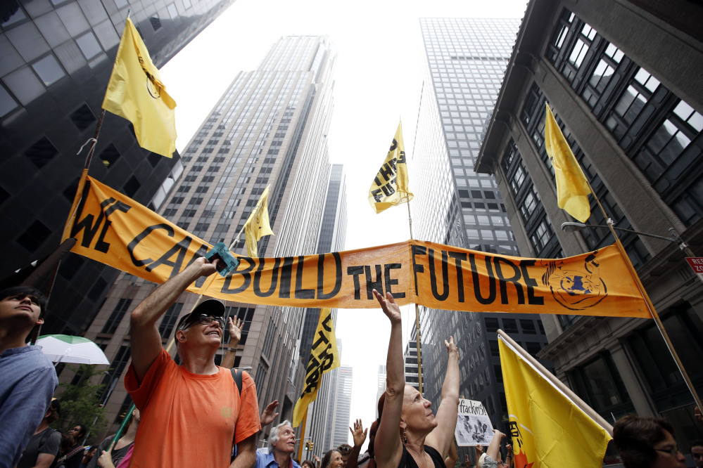 Demonstrators make their way down Sixth Avenue during the People's Climate March  in New York on Sunday.