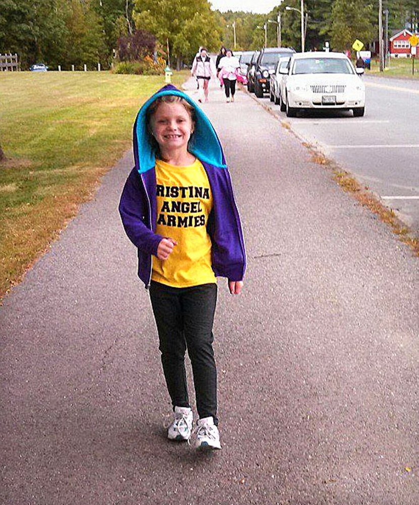 Cancer survivor Kristina Judkins walked Saturday in Waterville to raise money for children's cancer research.