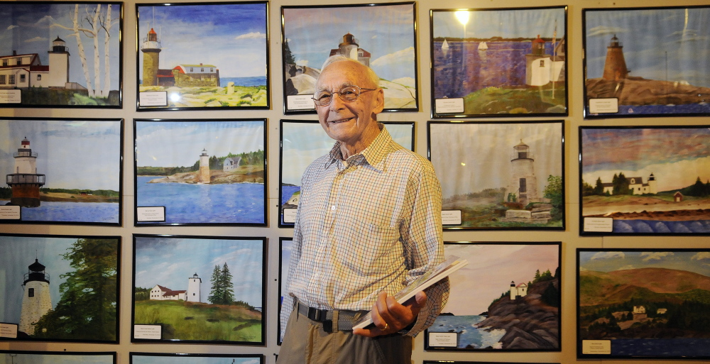 Ernest DeRaps of Richmond has painted 65 lighthouses in Maine and has all the paintings displayed in the studio of his home.