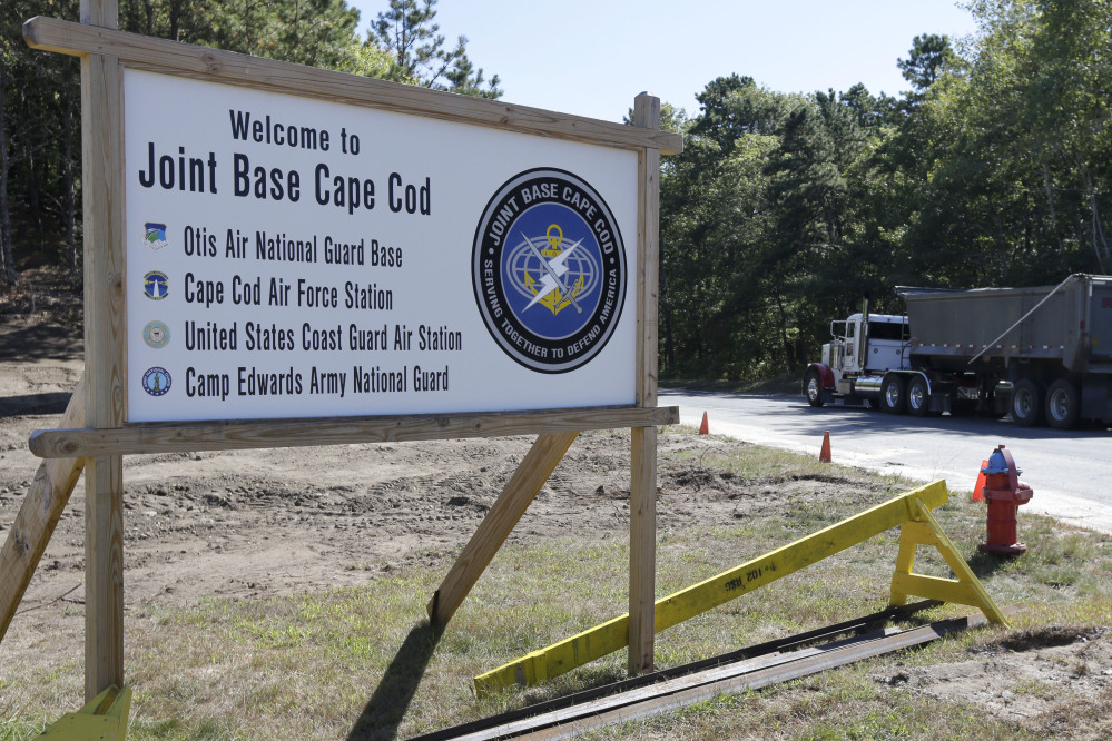 A truck drives past a welcome sign to Joint Base Cape Cod, Monday, in Sandwich, Mass.