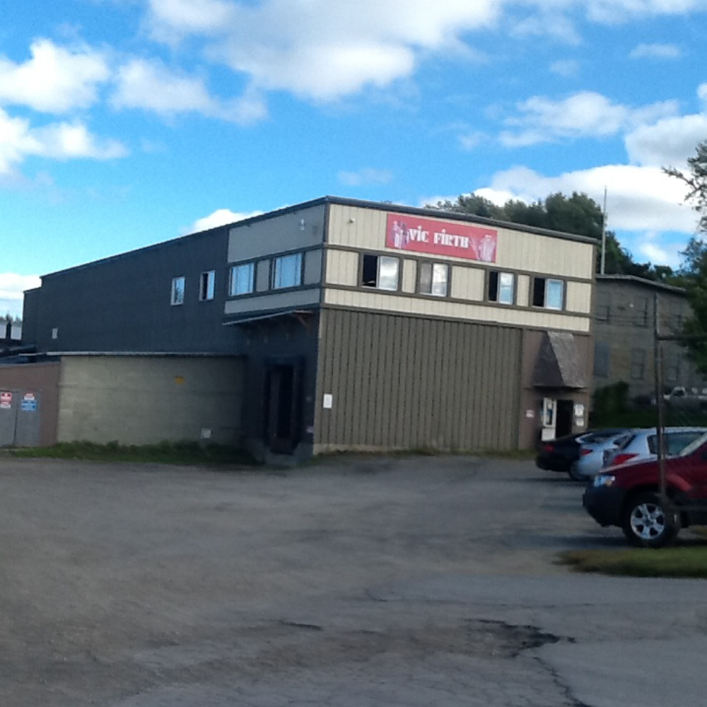 A fire that was started by a water cooler at the Vic Firth drumstick factory in Newport on Monday was contained under metal stairs, and the factory was not seriously damaged.