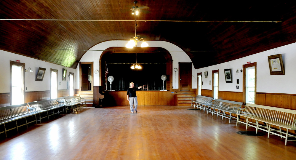 Kathleen Perelka, president of the Canaan Farmers Hall, walks through the dance hall portion of the former Canaan Grange on Monday. A fundraiser raffle will be held this Sunday for 1.28 acres of land, and the proceeds will be used to install an elevator.