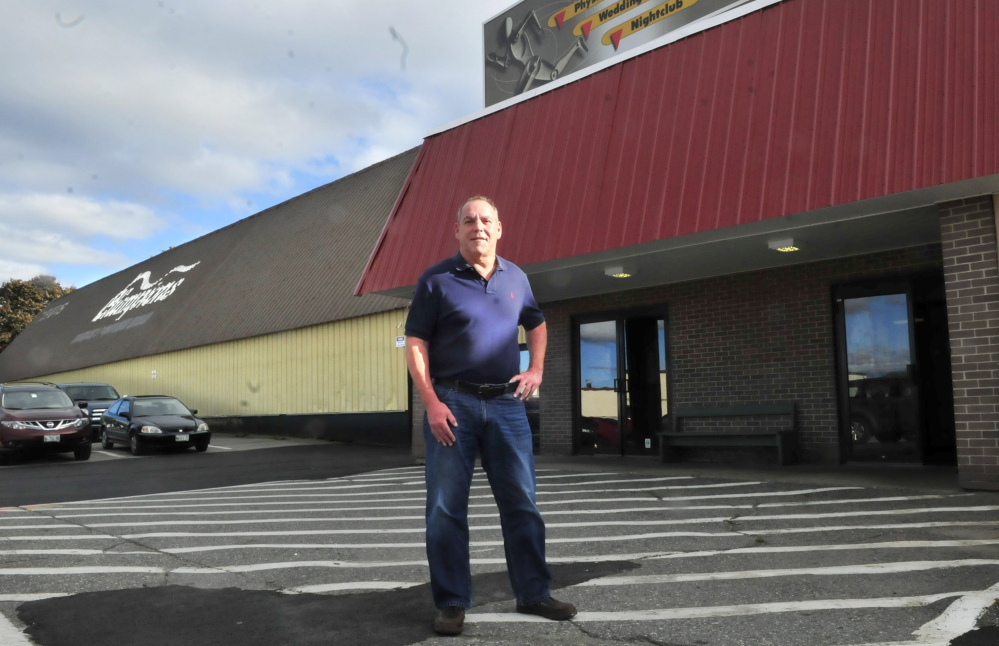 Charlie Giguere stands outside Champions Fitness Center in Waterville on Monday. Giguere will continue to manage the tennis and exercise center after reaching a deal with the building owner for improvements that will allow the 30-year-old iconic local business to continue operating.