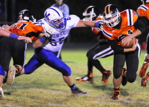 Staff photo by Joe Phelan   Gardiner offensive lineman Adrian Heath, left, blocks Morse defensive tackle Andrew Plummer to free up  Wyatt Blair during a game Friday at Hoch Field in Gardiner.