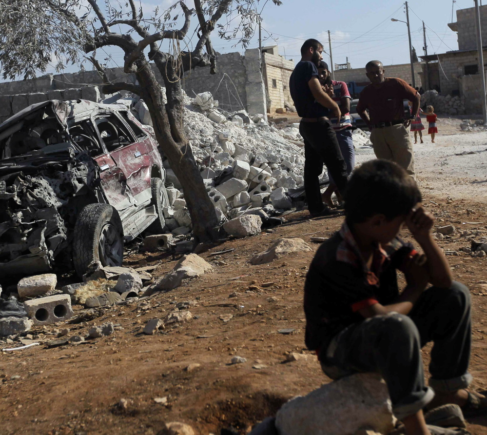 lasd;lfjlj ..... Residents inspect a damaged site in what activists say was a U.S. strike in Kfredrian, Idlib province September 23, 2014.   REUTERS/Abdalghne Karoof (SYRIA - Tags: POLITICS CIVIL UNREST CONFLICT) - RTR47EZZ