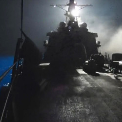 In this image made from video released by the U.S. Navy on Tuesday, missiles bound for Syrian Islamic State group targets are launched off of a U.S. Navy ship.