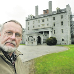 Peter Driscoll, who heads the Cemetery Project Committee that wants to put a memorial to the unidentified dead from the Augusta Mental Health Institute in Cony Cemetery on Hospital Street, stands in front of the Stone Building on the former state hospital grounds in 2012. The Augusta City Council will discuss the plan Thursday.