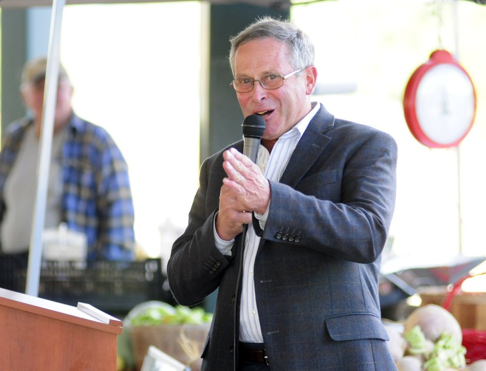 Walt Whitcomb, commissioner of Department of Agriculture, Conservation and Forestry, speaks on Tuesday at the farmers market at Mill Park in Augusta.