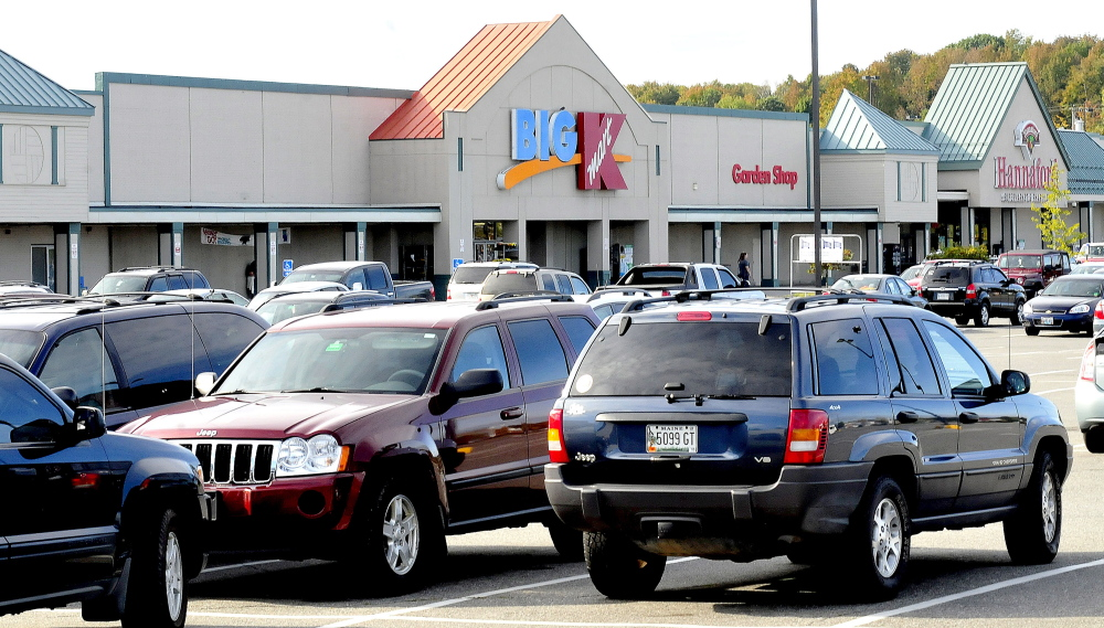 The parking lot at Elm Plaza in Waterville is filled with shoppers at stores including Kmart and Hannaford on Tuesday. The owners of the plaza have applied for a TIF district from the city to make improvements.