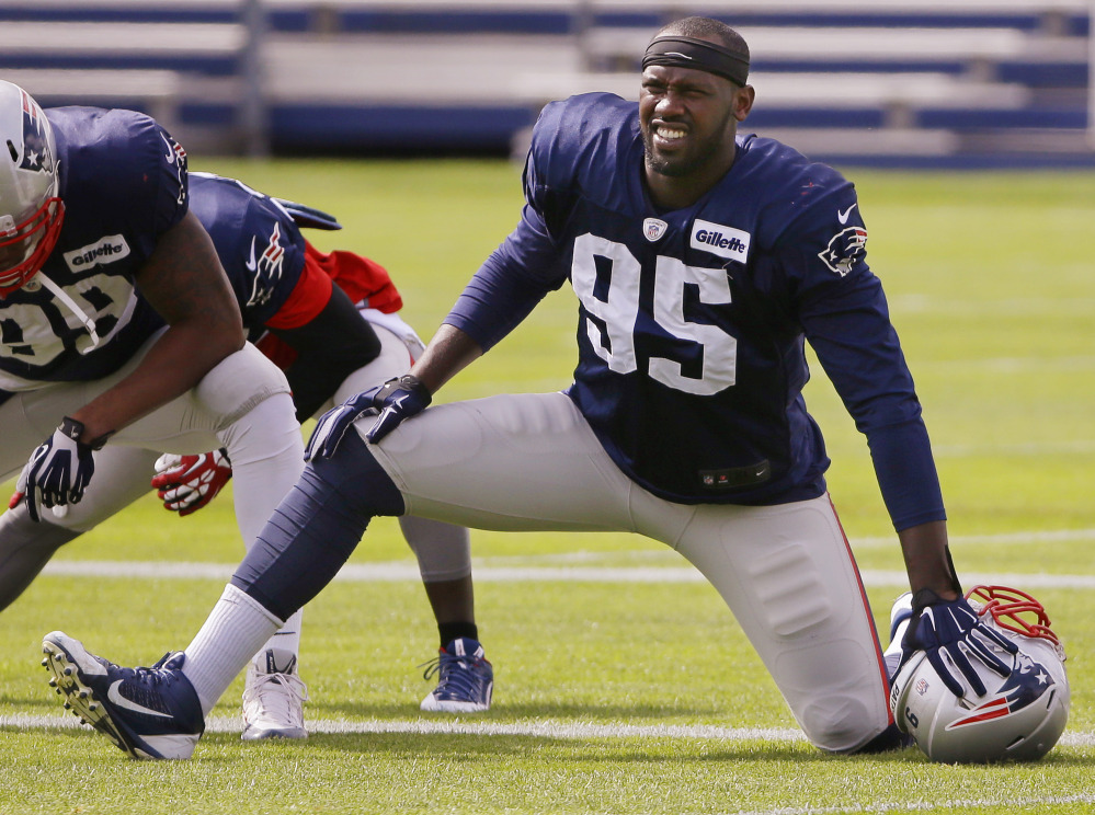 New England Patriots defensive end Chandler Jones (95) stretches before practice begins at the team's facility Wednesday in Foxborough, Mass. The Patriots will play the Kansas City Chiefs Monday night in Kansas City.