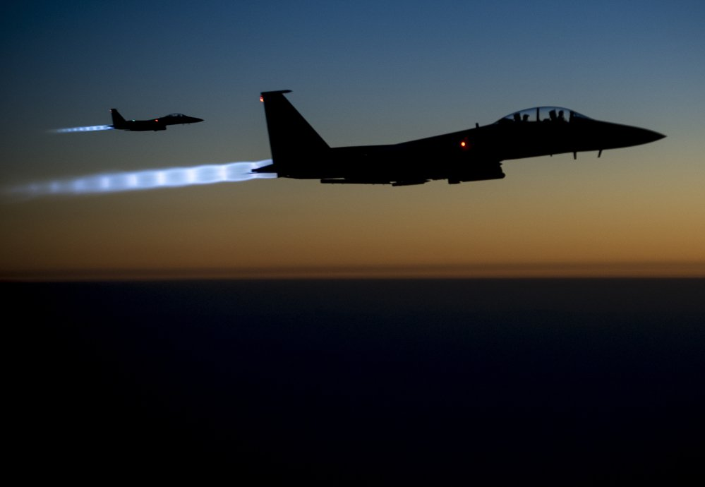 A pair of U.S. F-15E Strike Eagle flies over northern Iraq on Tuesday after conducting airstrikes in Syria.