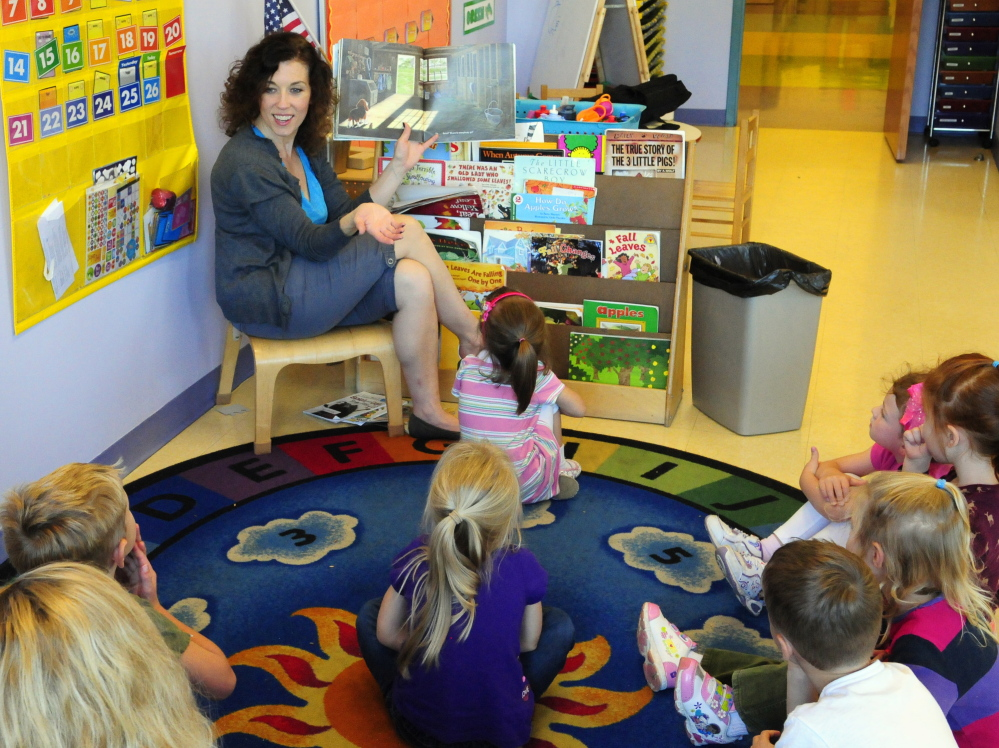 Susanne Murphy reads a book to a group of her 4-year old students on Friday in the Learning Center at the Kennebec Valley YMCA in Augusta. The YMCA and Lithgow PUblic Library are teaming up on a fundraiser that will benefit both organizations.