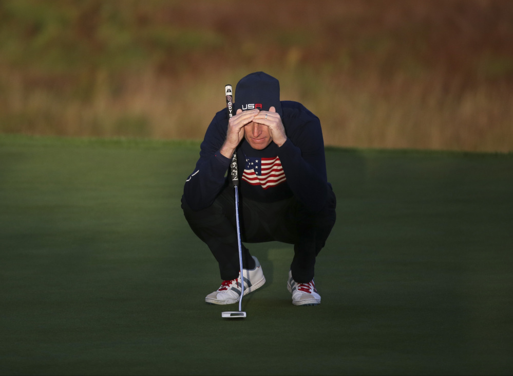 Jim Furyk of the US looks at his putt on the 1st green during the fourball match on the second day of the Ryder Cup golf tournament, at Gleneagles, Scotland, Saturday, Sept. 27, 2014. (AP Photo/Scott Heppell)