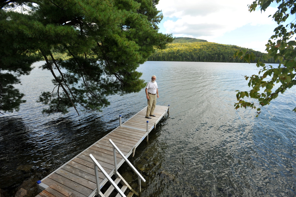 Craig Dickstein, of The Forks, stands on the dock of his home which is divided by the town line of Caratunk and The Forks. Dickstein is part of an effort for Pleasant Pond to secede from The Forks and become part of Caratunk.