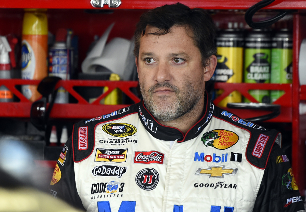 In this Sept. 13, 2014, file photo, Tony Stewart looks out from his garage during practice for the NASCAR Sprint Cup series auto race at Chicagoland Speedway in Joliet, Ill.