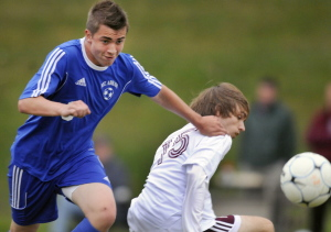 Mt. Abram's Bryson Walker, left, pushes Monmouth Academy's Ben Bolstridge during a soccer game Monday in Monmouth.
