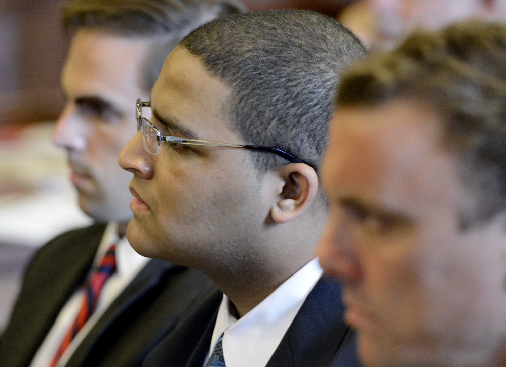 Anthony Pratt Jr., center, is flanked by his attorneys Dylan Boyd, left, and Peter Cyr as they listen to opening statements by the prosecution in the murder trial of Pratt at the Cumberland County Court House in Portland on Monday.