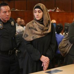 Ailina Tsarnaeva, sister of Boston Marathon bombing suspect Dzhokhar Tsarnaev, is escorted by a court officer during her appearance in Manhattan Criminal Court Tuesday in New York.