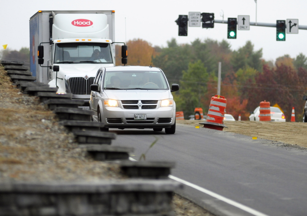 Vehicles head east on Tuesday toward the intersection of Smith Street and Western Avenue in Augusta. Residents expressed concern about not being able to see approaching traffic when they pull out of Smith Street onto Western Avenue.